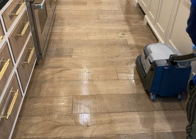 chem-dry tech performing wood floor cleaning in provo ut